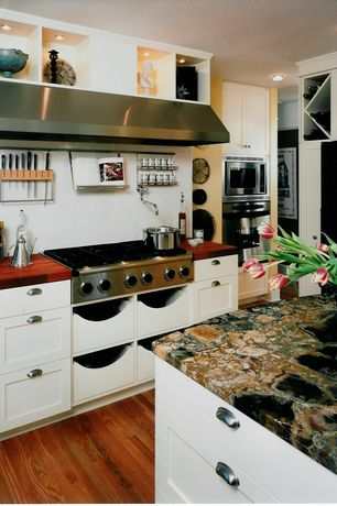 "Cottage Kitchen with Hickoryhardware williamsburg 1.49"" cup pull, Wood counters, L-shaped, Complex granite counters"