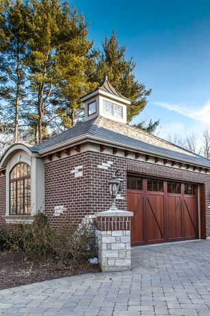 Traditional Garage with Exterior brick siding, Detached garage, Cupola, Carriage house style garage doors