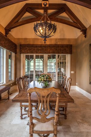 Traditional Dining Room with Window seat, French doors, Chandelier, Exposed beam, High ceiling, sandstone tile floors