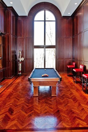 Traditional Game Room with Cathedral ceiling, Crown molding, can lights, Hardwood floors, picture window, Interlocking Pavers