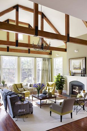 Contemporary Great Room with Paint, Wall sconce, Paint 2, double-hung window, Cement fireplace, Exposed beam, Chandelier