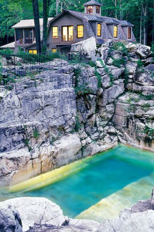 Rustic Swimming Pool with exterior stone floors, Quarry pool, French doors, Fence, Arched window