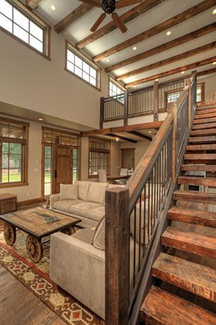 Country Staircase with Country wagon coffee table, Hardwood floors, Paint, Exposed beam, Microsuede sofa, Cathedral ceiling