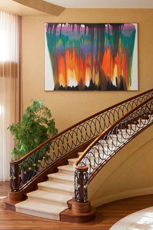 Modern Staircase with High ceiling, curved staircase, Laminate floors