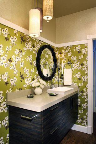 Contemporary Powder Room with European Cabinets, Pendant light, Flush, Laminate floors, Dupont Corian Bone, Vessel sink