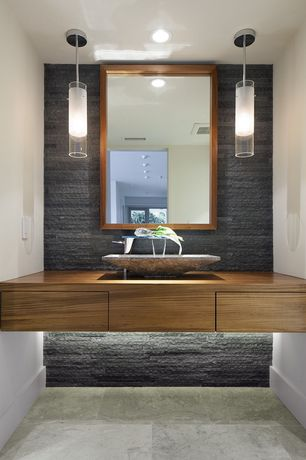 Contemporary Powder Room with Wood counters, stone tile floors, Pental - rustic cladding - silver quartzite, Flush