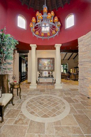 Mediterranean Entryway with slate floors, Chandelier, High ceiling, Exposed beam, Columns, Arched window
