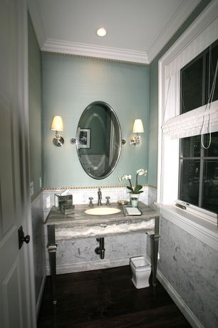 Traditional Powder Room with Soapstone counters, Wall sconce, Console sink, Gatco Designer II Oval Mirror, Hardwood floors