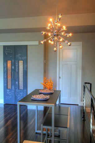 Contemporary Dining Room with Chandelier, Hardwood floors, High ceiling, specialty door