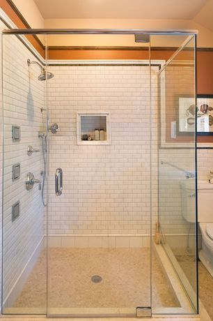 Modern Full Bathroom with penny tile floors, frameless showerdoor, White subway tile 3x6 glossy, Handheld showerhead