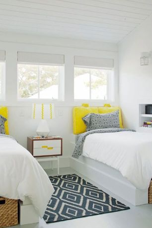 Contemporary Guest Bedroom with Concrete floors, West elm kite wool kilim, Yellow, Wall sconce, Built-in bookshelf
