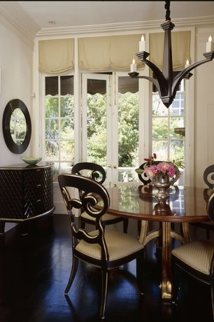 Traditional Dining Room with French doors, Chandelier, High ceiling, Crown molding, Laminate floors, Transom window