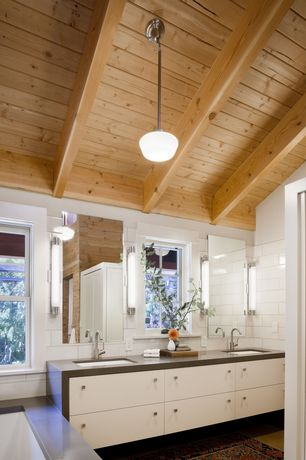 Contemporary Master Bathroom with High ceiling, Exposed beam, Soapstone counters, Wall Tiles, Inset cabinets, Wall sconce