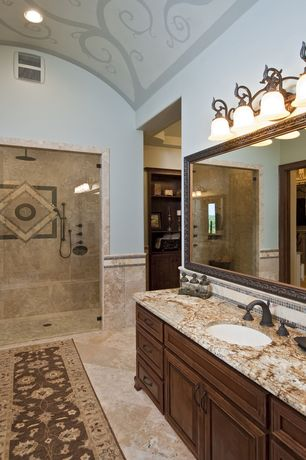 Mediterranean Master Bathroom with Paint 1, Undermount sink, stone tile floors, Shower, Inset cabinets, three quarter bath