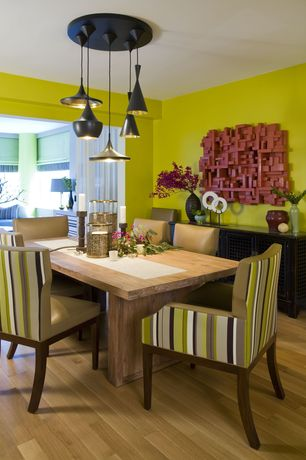 Contemporary Dining Room with Mamagreen Stripe Dining Arm Chair in Vertical Stripes, Pendant light, Laminate floors