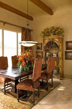 Mediterranean Dining Room with High ceiling, simple granite floors, Pendant light, picture window, Exposed beam