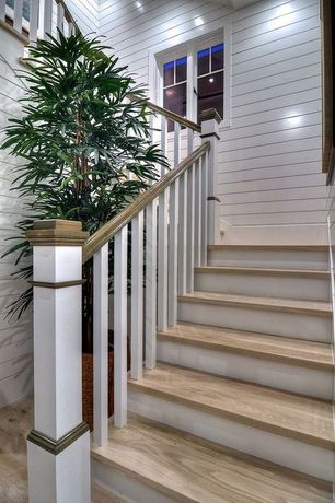 Traditional Staircase with Wood paneling, Hardwood floors, High ceiling, Paint, Morel finish, curved staircase
