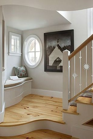 Eclectic Staircase with Window seat, High ceiling, Hardwood floors