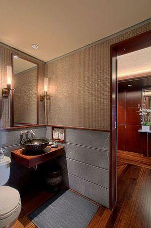 Modern Powder Room with Laminate floors, Vessel sink, Pental  brazilian black slate, Magic 1-light wall light, Powder room