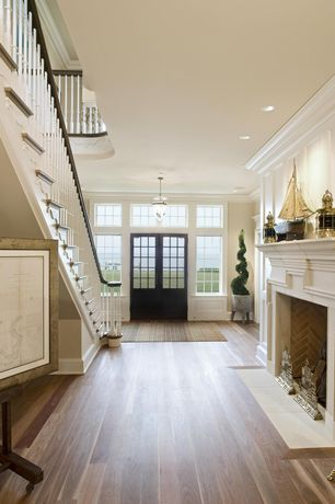Traditional Entryway with Crown molding, Glass panel door, Transom window, Hardwood floors, flush light, Loft