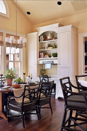 Contemporary Dining Room with double-hung window, Hardwood floors, High ceiling, Arched window, Built-in bookshelf
