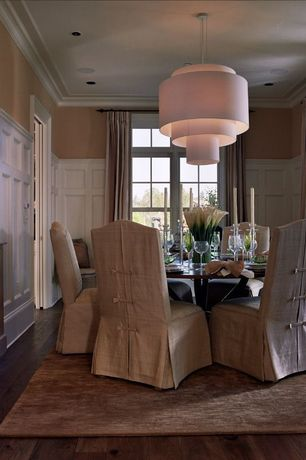 Contemporary Dining Room with Pottery Barn Ryden Chair Slipcover, Wainscotting, Crown molding, Pendant light, Hardwood floors