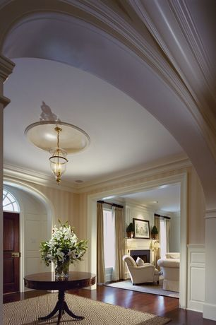 Traditional Entryway with interior wallpaper, Crown molding, High ceiling, Wainscotting, Ballard Designs Diamond Sisal Rug
