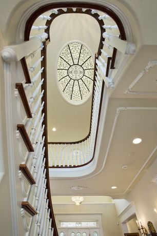 Traditional Staircase with Stained glass window, Skylight, can lights, curved staircase, Hardwood floors, Cathedral ceiling