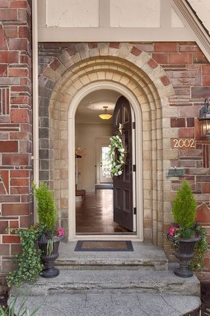 Traditional Front Door with exterior stone floors, six panel door, Glass panel door