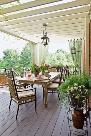 Traditional Deck with Brick wall, Trellis, Wrap around porch