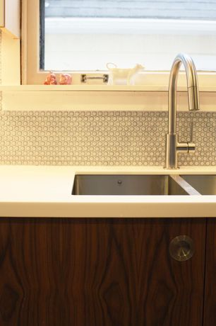 Modern Kitchen with Corian solid surface in designer white, Undermount sink, Corian counters, interior wallpaper, Penny Tile