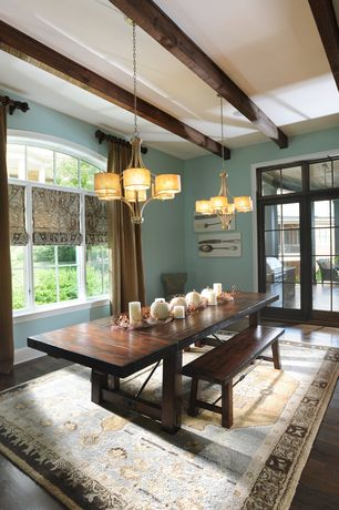Traditional Dining Room with Six Light Argentum Drum Shade Chandelier, Bryson Persian Style Rug, Arched window, Chandelier