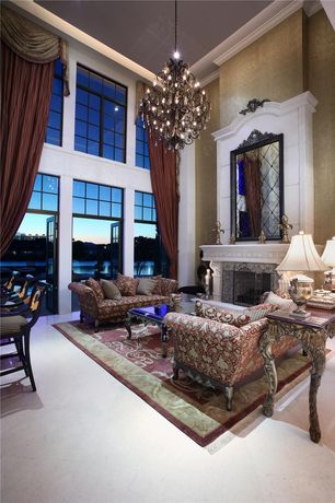 Traditional Great Room with Crown molding, Carpet, French doors, Cement fireplace, Chandelier, Transom window
