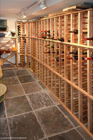Craftsman Wine Cellar with Built-in bookshelf, sandstone floors