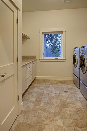 Craftsman Laundry Room with travertine floors