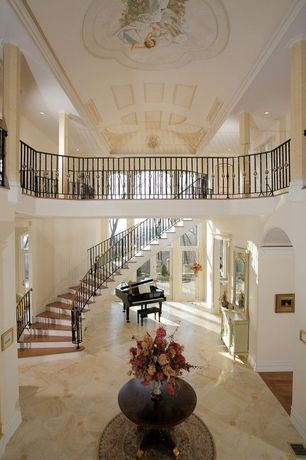 Traditional Hallway with simple marble floors, picture window, French doors, Cathedral ceiling, Crown molding
