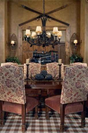 Eclectic Dining Room with Wall sconce, six panel door, Standard height, Carpet, Chandelier