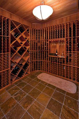 Rustic Wine Cellar with Undercabinet goblet storage, terracotta tile floors, Standard height, Built in shelf, flush light
