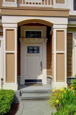 Craftsman Front Door with exterior stone floors, exterior awning, six panel door, Transom window, specialty window