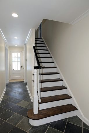Traditional Staircase with Standard height, stone tile floors, curved staircase