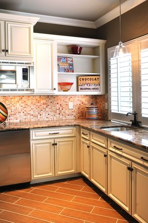 Traditional Kitchen with Built-in bookshelf, Raised panel, Ceramic Tile, Complex granite counters, Pendant light, Galley