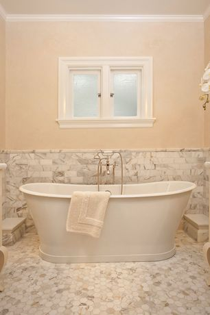 "Traditional Master Bathroom with penny tile floors, Crown molding, Signature Hardware 66"" Durham Bateau Cast Iron Skirted Tub"
