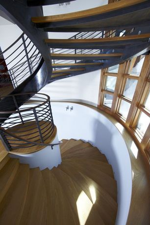 Contemporary Staircase with Wall sconce, Laminate floors, Spiral staircase, Cathedral ceiling, Casement
