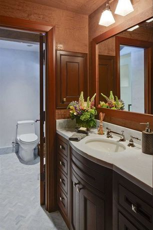 Traditional 3/4 Bathroom with herringbone tile floors, Simple Marble, Inset cabinets, Simple marble counters, Powder room