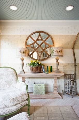 Contemporary Living Room with Melange rafferty wall mirror with compass fretwork, Walsh console table, Lyon chair