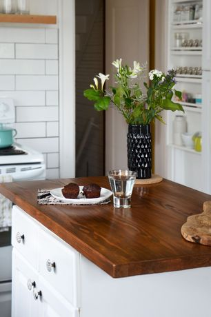 Eclectic Kitchen with Wood counters, Burl cutting board, Anthropologie nanette knob, Inset cabinets, One-wall, Kitchen island