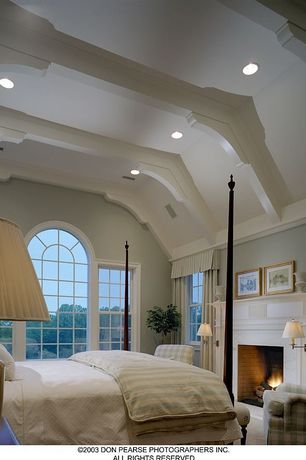 Contemporary Master Bedroom with Carpet, Standard height, Exposed beam, Cement fireplace, double-hung window, brick fireplace