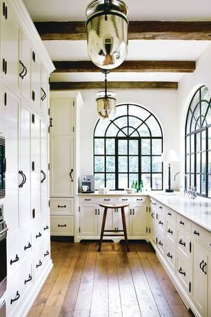 Eclectic Kitchen with Exposed beam, Corian counters, Undermount sink, U-shaped, Troy Lighting mercury pendant, Arched window