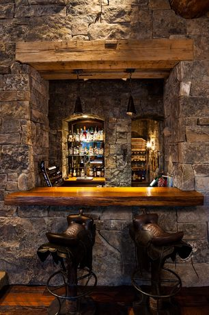 Rustic Bar with AFD Home Saddle Counter Stool, Pendant light, High ceiling, Hardwood floors, Western theme