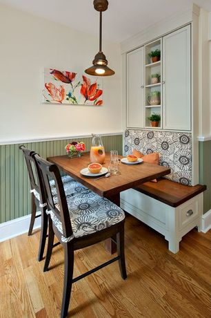 Traditional Dining Room with Hardwood floors, Wainscotting, Pendant light, Chair rail
